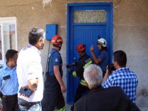 Evde uyuyakalan kadın, polis ve itfaiye ekiplerini harekete geçirdi
